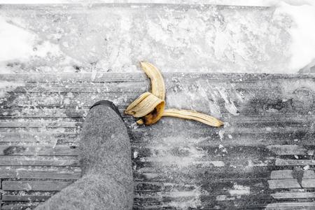 Overehead shot of banana skin on wooden steps, selective color image