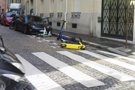 A scooter abandoned on pedestrian cross, urban scene