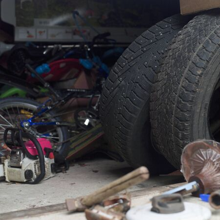 Old tires on a garage floor, indoor close up