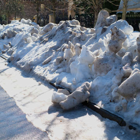 Piles of melting snow on the street, springtime outdoor shot