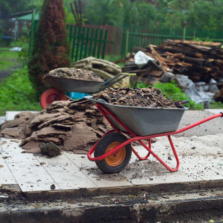 Construction yard with a trolley full of garbage, outdoor shot