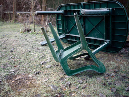 Abandoned and turned over plastic garden furniture, autumn daytime shot