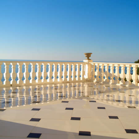 Luxury llooking marble embankment, the sea nad blue sky in the background