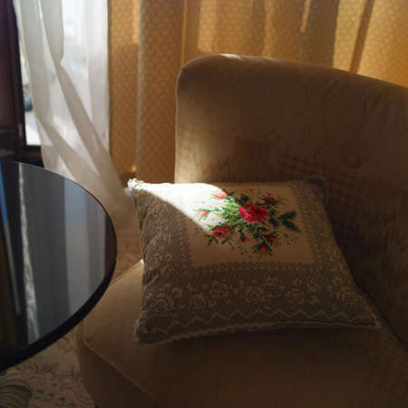 A pillow on armchair, interior close-up image Stock Photo