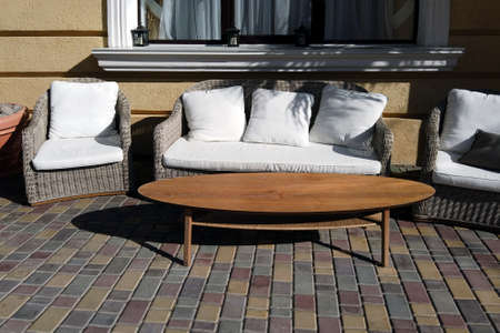 Cozy garden furniture in patio or veranda, sunny day shot