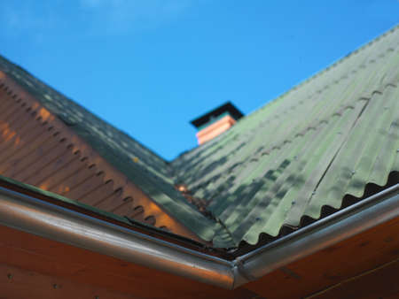 New onduline roof of a wooden house against the sky