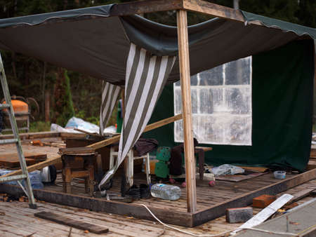 A messy tent with scattered household goods, outdoor shot Stock Photo