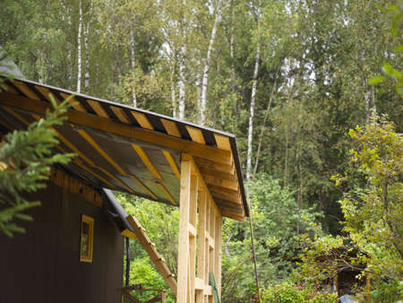 construction of a wooden addition to a house, outdoor shot