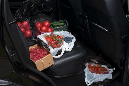 fruits and vegetables on a car backseat, outdoor cropped shot 版權商用圖片