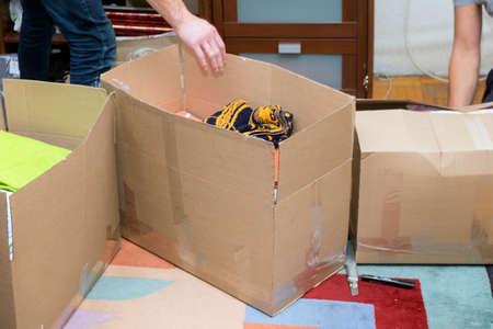 people unboxing household stuff or personal belongings, indoor cropped shot 版權商用圖片