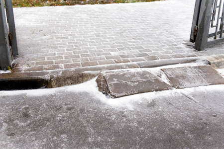 Tiled pavement covered with ice, outdoor  daytime image