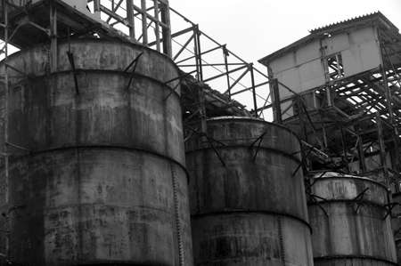Outdoor shot of a seemingly abandoned old factory in black and white