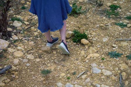 female walking down a mountain, outdoor cropped shot 版權商用圖片