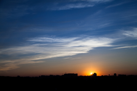 Dramatic: Sunset in the city beyond the horizon from the height Stock Photo