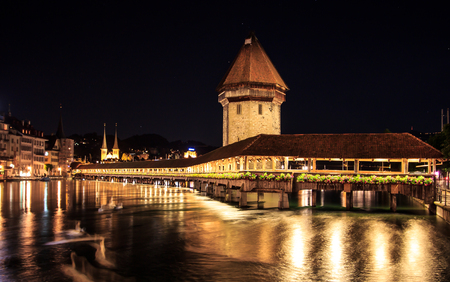 Chapel Bridge and Water Tower at night with reflection on the lake, Lucerne, Switzerland Stock Photo