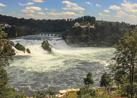 Panorama view of Rhine Falls with Castle Laufen. Rhine Falls is the biggest plain waterfall in Europe, Neuhausen, Switzerland