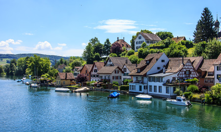 city park boat house: Beautiful panoramic view of Stein Am Rhein town on Rhine River in beauty swiss canton of Schaffhausen, alpine landscape and clear blue sky in warm sunny summer day. Stock Photo