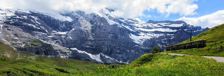 Majestic panoramic view of scenery along a swiss railways train, connecting Kleine Scheidegg to Wengernalp stations, Switzerland.