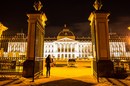 ministry: Asian woman standing in front of the gate of majestic Belgian Federal Parliament in the Palace of the Nation at night in Brussels, Belgium, Europe. Editorial