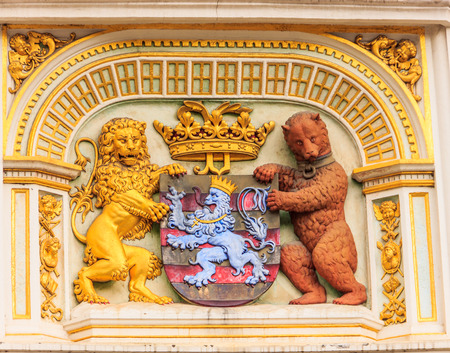Heraldic lion and bear, town hall Coat of arms , the city arm of Bruges, Belgium, Europe. Editorial