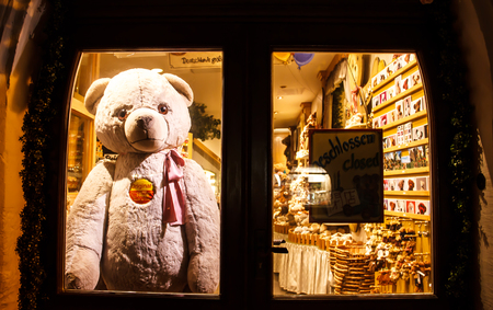 ROTHENBURG OB DER TAUBER, GERMANY-September 11, 2016: Teddy Bear Rothenburg placed behind the door after the shop closed