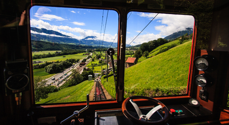 monch: Begin your journey and discover switzerland with famous traditional swiss railway train ,departing from train station, to through beautiful swiss alpine scenery toward top of majestic mountain peaks in Switzerland, Europe.