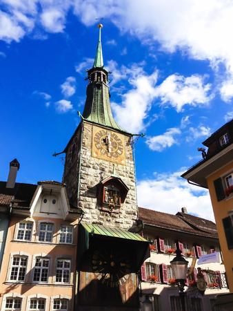 storied: Solothurn clock tower - with storied clock and the oldest construction in the whole town, Solothurn, Switzerland, Europe. Solothurn is the capital of the Solothurn canton, Switzerland. It is located on the banks of Aare river and on the foot of the Weisse Editorial