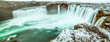 Majestic winter morning panoramic scene on the Godafoss, Waterfall of god, B�r�ardalur district, Iceland, Europe. Natural beauty of water falls from Skjalfandafljot river and B�r�ardalur valley as background.