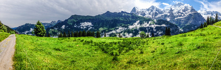 monch: Spectacular panoramic view of Eiger, Monch, Jungfrau mountains from Murren-Gimmelwald trail, Swiss alps, Bernese Oberland, Berne Canton, Switzerland, Europe. Great outdoor trail, best scenery for family activities, start from Lauterbrunnen station.