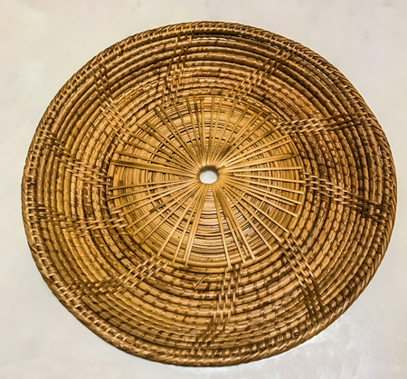 lacquer ware: Empty bamboo rattan woven tray place mat on the white marble table background