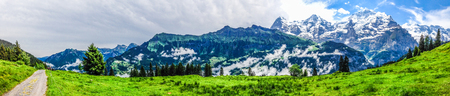 Beautiful Panorama view of Swiss Alps mountains from Murren-Gimmelwald trail, Jungfrau Region, Bernese Oberland, Berne Canton, Switzerland, Europe. Great outdoor, best scenery for family holidays activities.