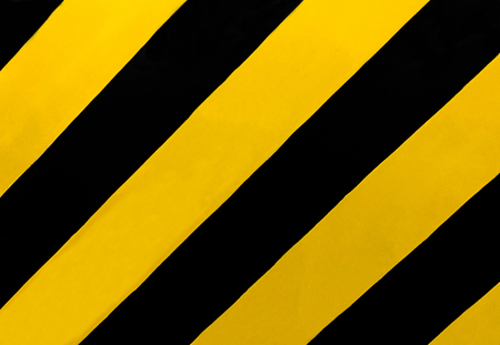 Traffic Sign: A rectangular sign with diagonal yellow and black stripes, wherever there is a median or other obstruction. Drive in the direction of the slope of the stripes to avoid the obstructions. Stock Photo