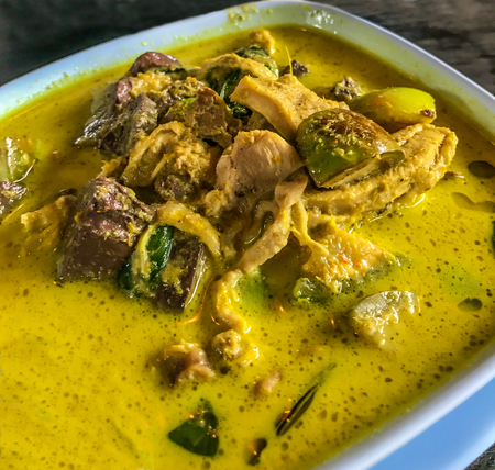 Asian Thai Food, Gang Keow Wan Gai or Thai green curry with chicken in the bowl on table background, one of the most famous Thai dishes that sought after.