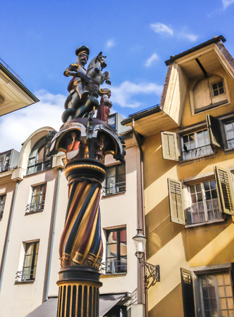 St George and dragon, polychrome statue of fountain of St George (1548), Solothurn, Solothurn, Switzerland, Europe. Stock Photo - 85380508