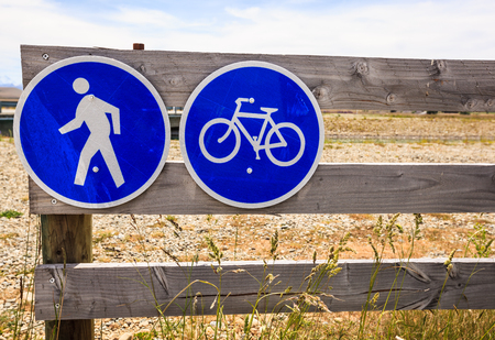 Prohibitory traffic sign. No car entry sign. No motor vehicle. Allow only bicycle and pedestrian on the wooden fence. 写真素材