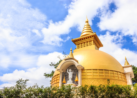 Beautiful view of Sino-Vietnamese Zen Buddhist temple Chua Truc Lam in a sunny summer day with blue sky and smooth cloud, outside the resort town of Dalat, Vietnam Banco de Imagens