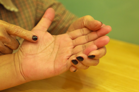 Old woman telling fortune for young man through Palm reading. Palm Reading, Palmistry Concept.