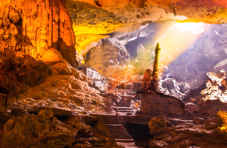 Beautiful gold sunlight shining to Sung Sot Cave or Surprise Grotto on Bo Hon Island is one of finest and widest grottoes of Ha Long Bay