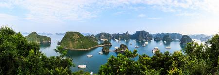 Panoramic view of Ha Long Bay islands, tourist boat and seascape, Ha Long, Vietnam.