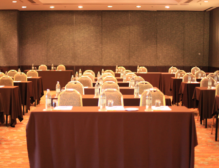 an empty conference meeting room in seminar hall with tables and chairs background