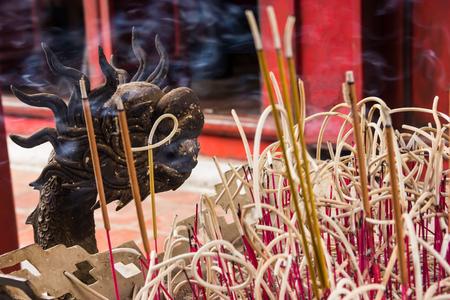 Hanoi, Vietnam - October 21, 2017: detailed decorative pattern of dragon Joss stick incense pot inside the Temple of Literature (Van Mieu) in Hanoi, Vietnam Editorial