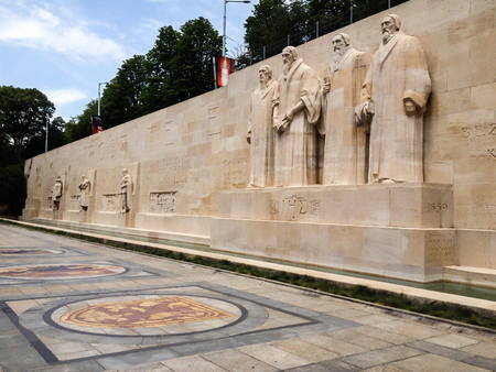 Geneva, Switzerland - June 28, 2012: Reformation Wall in Parc Des Bastions, was built into old city walls. Calvinist monument statues are William Farel, John Calvin, Theodore de Beze and John Knox Sajtókép