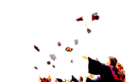 Graduate Students throwing mortarboards in the air in university graduation success ceremony. Congratulation on Education Success, Graduation Ceremony university graduates, Commencement Day Concept Stock Photo