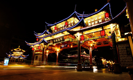 Chengdu, China - September 7, 2012: Night view of the ancient Chinese gate at Qintai Road historic district, Chengdu, Sichuan, People Republic of China Stock Photo