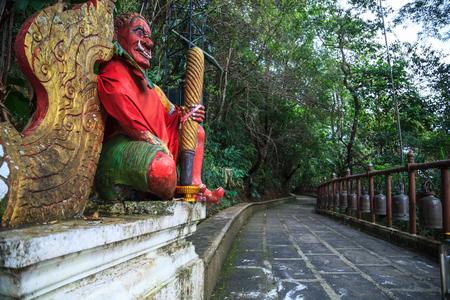 Giant Gate Guardian at temple entrance  to Wat Phra That Doi Tung, Chiang Rai, Thailand. Thai Travel Tourism.