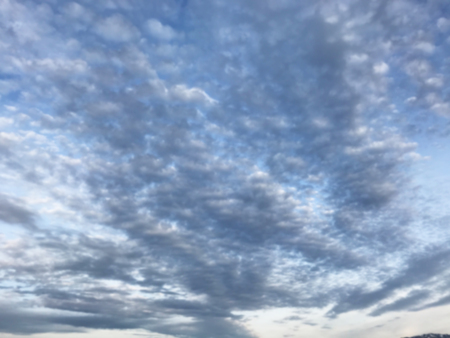 defocused natural blue cloudscape landscape, cirrocumulus cloud form or pattern in bright day morning or afternoon sky background. Weather, Atmosphere, Meteorology, Nature concept.