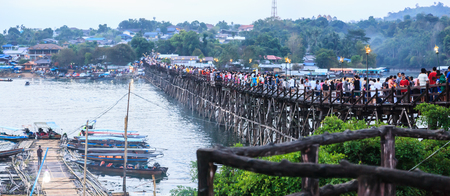 Kanchanaburi, Thailand - December 30, 2018: Tourists crowded on Saphan Mon Wooden Bridge (Mon Bridge), longest wooden bridge of Thailand during New Year Holidays, Sangkhlaburi, Kanchanaburi, Thailand.