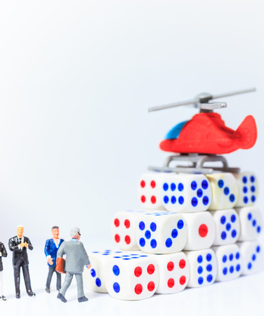 business leader walking to chopper (helicopter) on dice steps of success, fast lane to financial freedom. Risk and Reward, Probability, Randomness, Insight, Strategy, Decision Making and Rich concept
