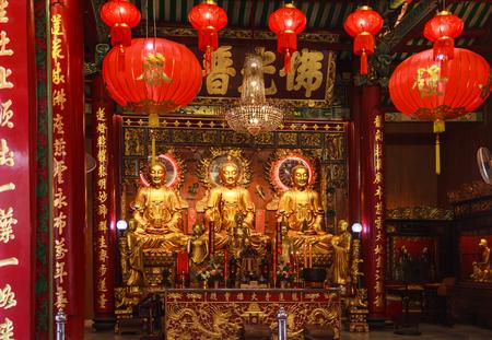Bangkok, Thailand - January 27, 2019: The three presiding Buddha Images in Wat Mangkon Kamalawat (The Temple of the Dragon Lotus), Bangkok Chinatown's most significant Chinese Mahayana Buddhist temple Sajtókép