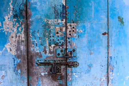 vintage retro wooden door and slide lock. Home interior architectural design, plain tropical blue painted texture wood panel board door wall in old traditional Asian house, Wallpaper, backdrop concept